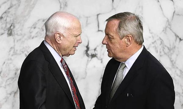 Sen. John McCain, R-Ariz., talks Tuesday with Sen. Dick Durbin, D-Ill. The Syria issue transcends partisan politics.