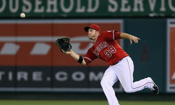 Angels right fielder J.B. Shuck makes a catch during Monday's game against the Tampa Bay Rays. Shuck has matured into fulfilling a number of valuable roles for the team.