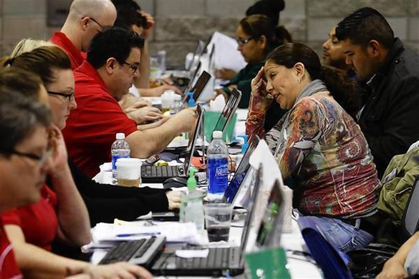 Home owners speak with Bank of America representatives as they try to get home loan modifications during the Neighborhood Assistance Corporation of America event in Phoenix.