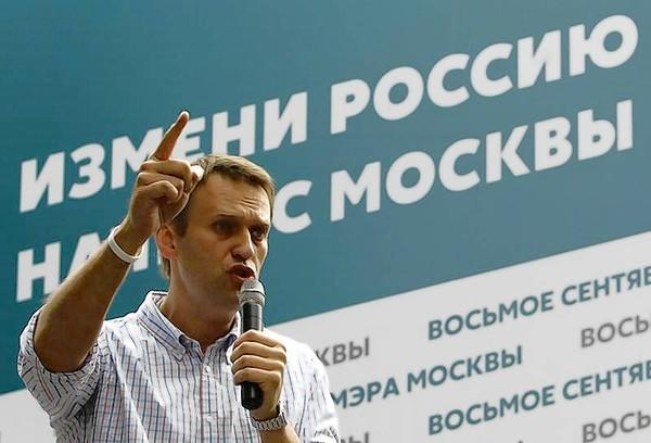 Russia's opposition leader and anti-graft blogger Navalny speaks to the crowd in Moscow.