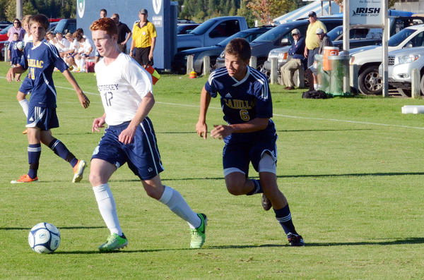 Petoskey senior Ethan Cartwright (left) dribbles the ball ahead of Cadillacs Tyler Neiss during Tuesdays Big North Conference match at the Click Road Soccer Complex. Cartwright scored a pair of goals as the Northmen defeated the Vikings, 3-0, to improve to 4-4-1 overall, 3-0 league.
