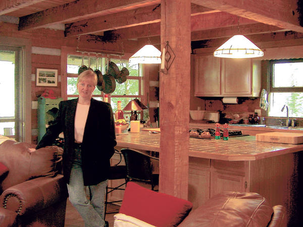 "Brenda Thompson, owner of Special ""Finds..."" is shown in one of her favorite, now sold, listings. The cabin is in the mountains of western North Carolina, near Asheville."