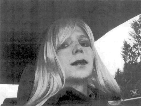 In this undated file photo provided by the U.S. Army, Pvt. Chelsea Manning, who was previously known as Bradley Manning, is wearing a wig and lipstick. The day after sentencing in her court martial, Manning announced that she wanted to live as a woman.