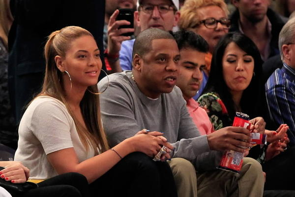 Recording artists Jay-Z and Beyonce watch the New York Knicks play the New Jersey Nets at Madison Square Garden on February 20, 2012 in New York City.