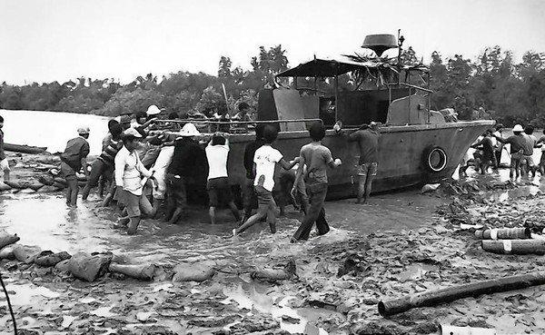 "Cleaning up on the set of ""Apocalypse Now"" after a typhoon halted production, 1976..."