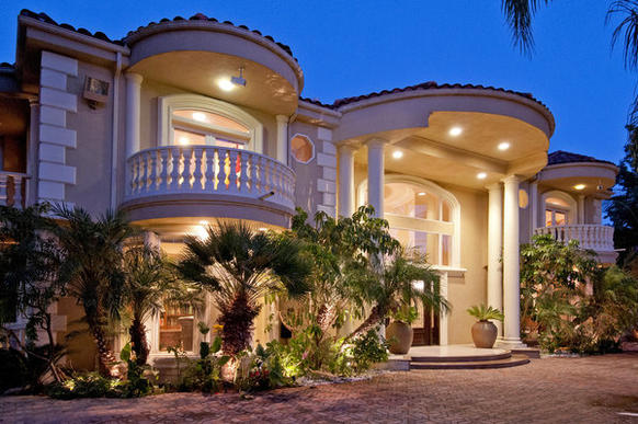 Columns define the Mediterranean home's two-story entry.