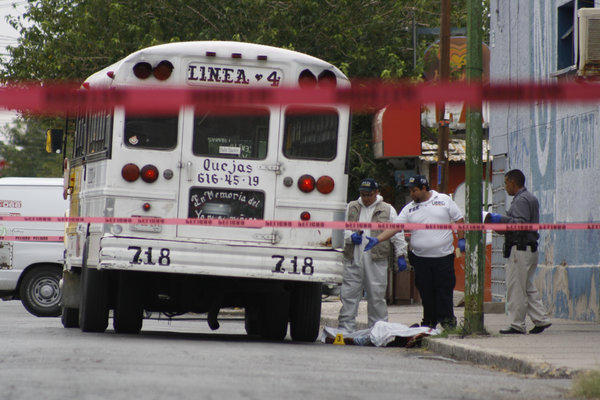 "Forensic workers last month examine the scene where a bus driver was allegedly killed by a self-styled ""bus driver hunter"" in Ciudad Juarez, Mexico."