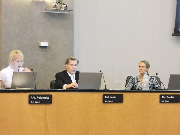 From left, Aldermen Dannee Polomsky (3rd Ward), Scott Levin (5th Ward) and Marti Deuter (1st Ward) discuss the Addison Avenue garage project Sept. 3.
