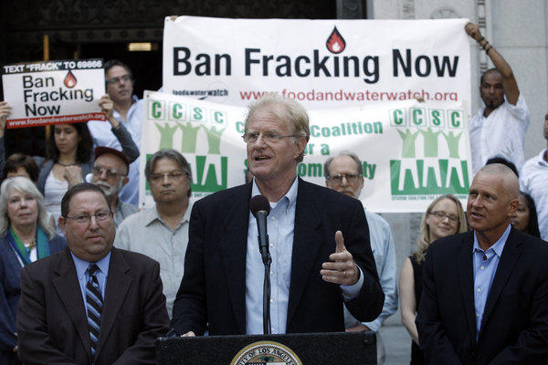 Actor and environmental activist Ed Begley Jr., flanked by Los Angeles City Councilmen Paul Koretz, left, and Mike Bonin, speaks at a news conference on the City Hall steps in support of a ban on fracking in Los Angeles.