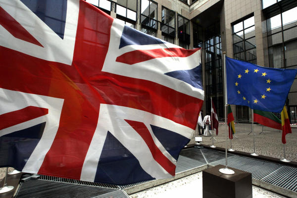 A European flag and the Union Jack hang in front of the European Union's headquarters building in Brussels. Ivan Rogers, one of Prime Minister David Cameron's senior advisors, is to become Britain's new ambassador to the European Union.