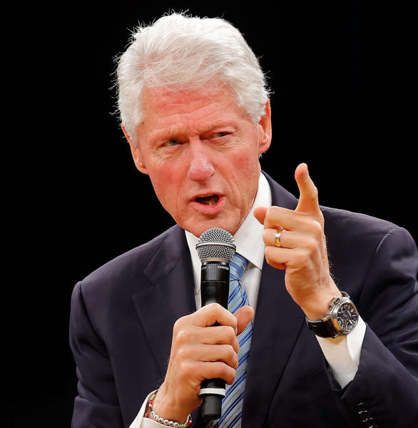 Former US President and founder of the Clinton Foundation Bill Clinton reads a discussion onstage during the 'Embrace Tomorrow - A Conversation Without Borders.'