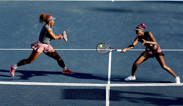 Venus Williams, teamed with her sister Serena, hits a forehand return during their third-round doubles victory against Anastasia Pavlyuchenkova and Lucie Safarova.
