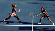 U.S. Open: Williams sisters advance to fourth round in doubles