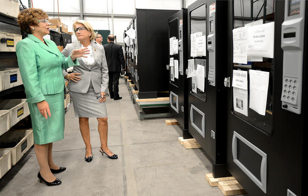 U.S. Rep. Shelley Moore Capito, right, tours Automated Merchandising Systems in Kearneysville, W.Va. during a busy day in the Eastern Panhandle on Wednesday. Automated Merchandising Systems President Sharon Shull shows Capito, R-W.Va., a vending machine that was manufactured at the company.