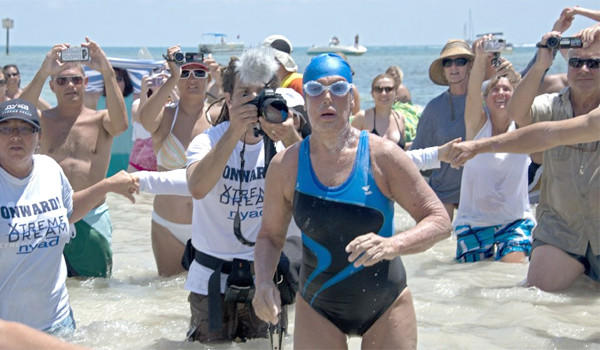 Endurance swimmer Diana Nyad emerges from the water on the coast of Key West, Fla. after completing a 110-mile swim from Cuba to the United States on Monday.
