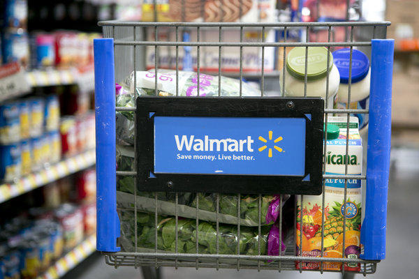 Grocery items in a cart at a Wal-Mart store. A judge ruled Wednesday that Burbank must rescind building permits it issued to Wal-Mart for a store in the Empire Center.