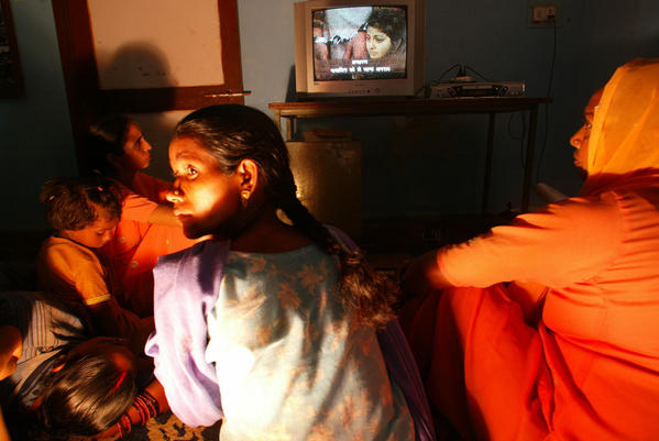 In a 2004 photo, women at a New Delhi shelter for victims of dowry violence view a video recounting the persistent problem of in-laws resorting to violence against young brides to extort more dowry from their parents. The upward trend in dowry deaths continues despite modernization in the country.