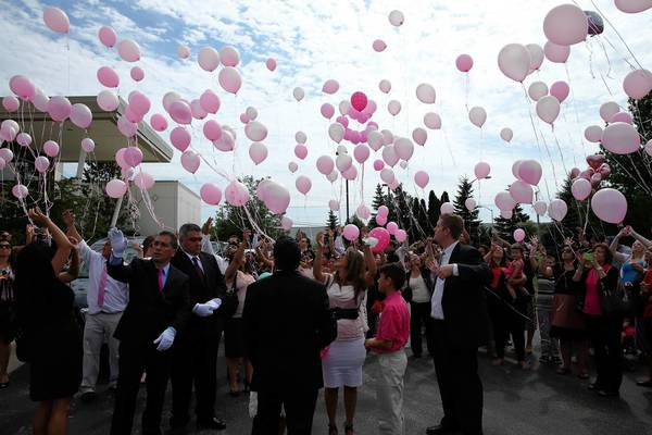 Mourners release pink balloons Wednesday after Mireya Cardenas' funeral service in Libertyville. She loved the color pink, according to friends and family.