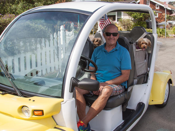 Jeff King and his dogs, Molly and Maggie in their custom seats.