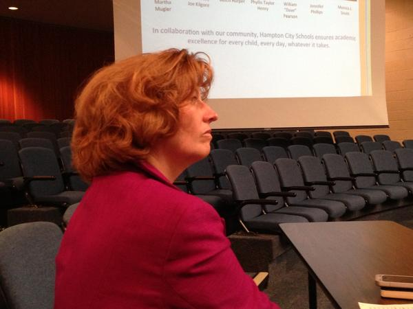 Diana Gulotta, the division's new spokeswoman, listens to a presentation during a School Board meeting.