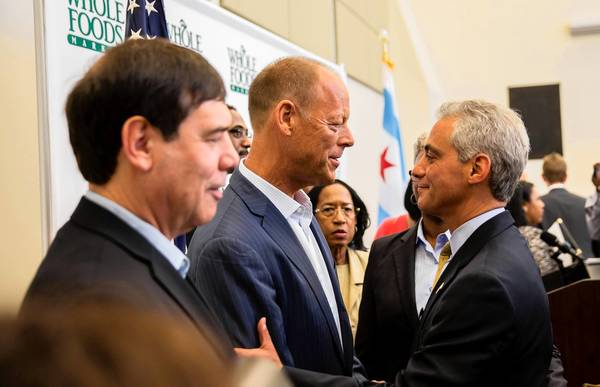 Whole Foods co-CEO Walter Robb and Mayor Rahm Emanuel chat Wednesday after announcing plans to bring a Whole Foods Market to Englewood . At left is Michael Bashaw, president of Whole Foods' Midwest region.