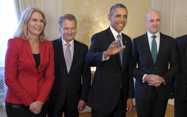 President Barack Obama (C), Danish Prime Minister Helle Thorning-Schmidt (left), Finnish President Sauli Niinisto and Swedish Prime Minister Fredrik Reinfeldt (right) pose for a photo during a dinner in Stockholm on Wednesday. (Reuters Photo)