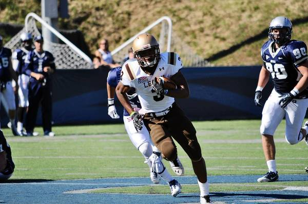 Lehigh's Josh Parris (3) outruns Georgetown's defenders during their game on Saturday, October 13, 2012.