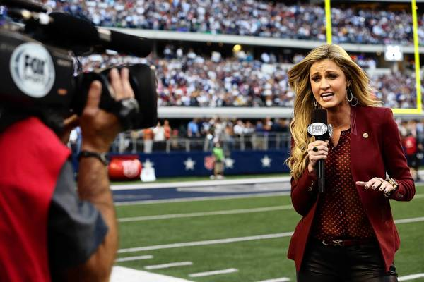 ARLINGTON, TX - NOVEMBER 22: Sideline reporter Erin Andrews during a Thanksgiving Day game between the Washington Redskins and the Dallas Cowboys at Cowboys Stadium on November 22, 2012 in Arlington, Texas.