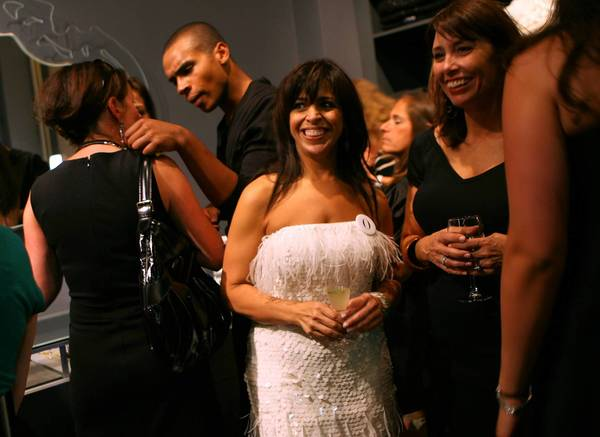 Fashion designer Maria Pinto, center, mingles in 2008 with her guests at the opening of her boutique. She closed the boutique two years later and is now launching a new clothing line on Kickstarter.