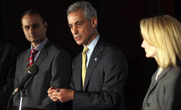 Mayor Rahm Emanuel in 2011 when he announced his financial team, which included former comptroller Amer Ahmad, left, and Lois Scott, his chief financial officer.