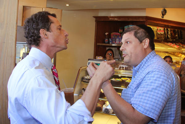 Anthony Weiner, left, who is seeking the Democratic nomination to run for the New York City's mayor, has a heated argument with Shaul Kessler at Weiss Bakery in the Boro Park neighborhood in Brooklyn.