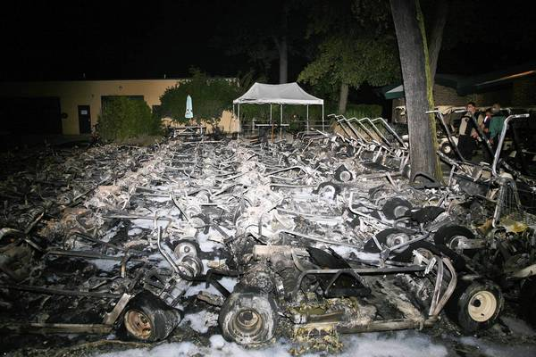 Cook County investigators are searching for those responsible for setting fire to 46 golf carts Monday night at Chick Evans golf course in Morton Grove.