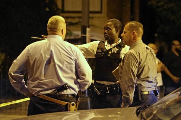 Chicago police investigate the scene of a shooting on the 6900 block of South Jefferey Avenue in Chicago on Wednesday night.