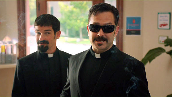"Co-directors and co-stars Ben Garant and Thomas Lennon star as exorcists dispatched from the Vatican to investigate a possible possession in the movie ""Hell Baby."""