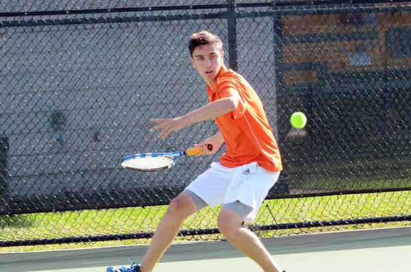 Harbor Springs senior Sam Dart volleys during his No. 1 singles match with Boyne Citys Logan Orban Wednesday in Harbor Springs. Dart defeated Orban, 6-1, 6-0, as the Rams defeated the Ramblers, 6-2.