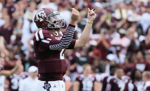 "Johnny Manziel gives the ""money"" sign during a game against Rice."