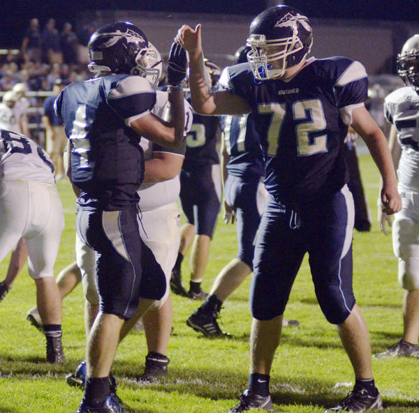Petoskey senior offensive lineman Jeremy Hiatt (right) congratulates senior running back Chase Ledingham during Friday's non-league contest over Sault Ste. Marie at Curtis Field. The Northmen, 1-0, will face Hastings, 0-1, at 7 p.m. Friday, Sept. 6, in a non-league contest at Curtis Field.