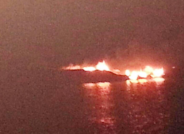 A 34-foot sailboat burns in Lake Charlevoix on Friday night after a problem with a cooking stove cause a fire on board.