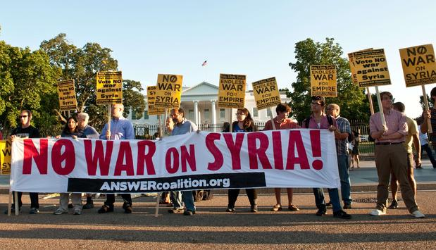 Demonstrators opposed to the U.S. attacking Syria rally in front of the White House on Tuesday.