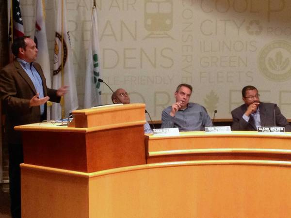 John Houseal, left, discusses a plan for Oak Park's future with the Oak Park Village Board.
