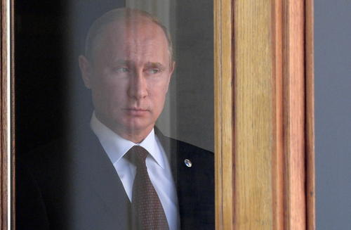 President Vladimir Putin waits for heads of state at the start of the G20 summit on September 5, 2013 in Saint Petersburg.