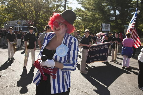 Emily Glass laughs at a friend while participating in the Park Road Parade in West Hartford on October 2, 2010.