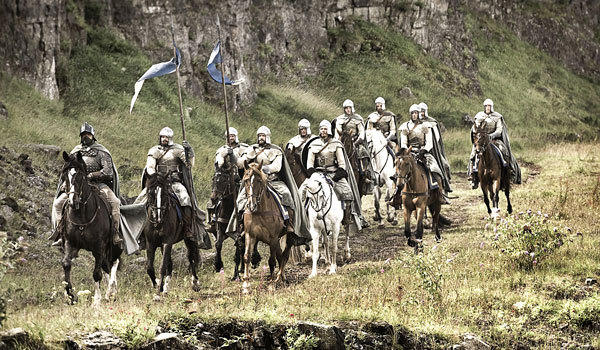 "Knights ride in a scene from ""Game of Thrones."""