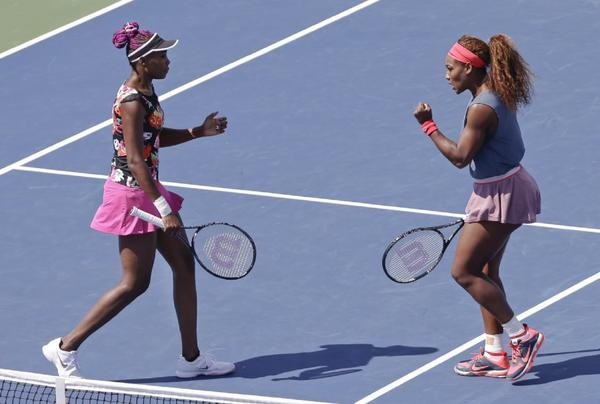 Venus, left, and Serena Williams advanced to the semifinals in women's doubles at the U.S Open.