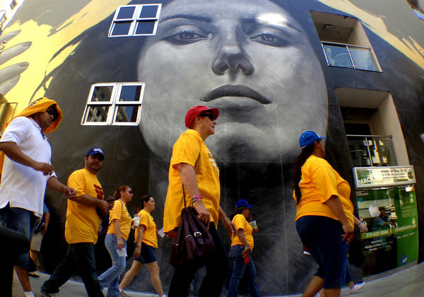 Labor-backed activists marched through downtown Los Angeles calling for better jobs.