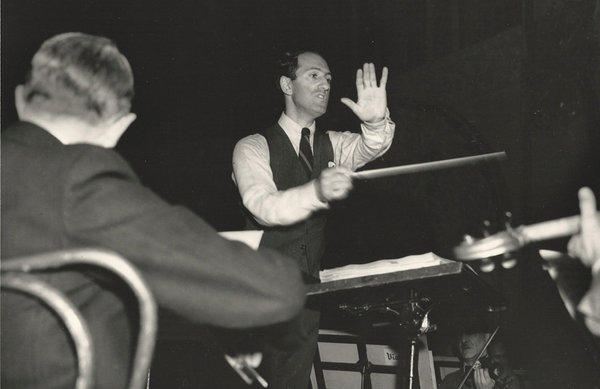 George Gershwin conducts members of the Los Angeles Philharmonic and other players during a rehearsal for two benefit concerts for musicians in February 1937. Playing piano during the performance Gershwin made a surprising mistake. The lapse was the first public manifestation of an undiagnosed brain tumor; Gershwin died five months later.