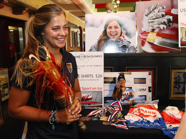 Kate Hansen, a graduate of La Cañada High School, holds an Olympic torch decoration from the 1984 Olympics for a photo at Los Gringos Locos for a fundraiser to help raise money for her to train with the U.S. Women's Olympic Luge Team on Thursday, August 29, 2013. The restaurant donated 15% of the night's tabs to her fundraiser fund.
