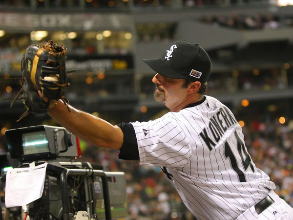 Chicago White Sox first baseman Paul Konerko leans into the dugout to catch a pop up on Aug. 24.