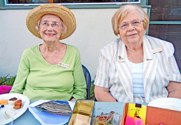 """Joey Mitchell and Eileen St. Amand were the official greeters for the Tournament's Hamburger Night """"Happy Hour."""""""