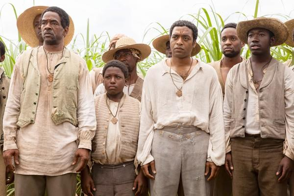 "Chiwetel Ejiofor stars as Solomon Northup, center, a freeman abducted and sold into bondage in ""12 Years a Slave."""